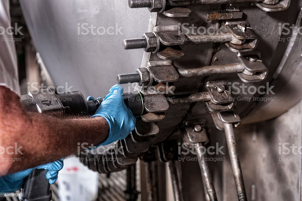 Close Up of Maintenance Technician Sealing Water Filtration System stock photo