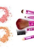 close up of make up powder and brush on white background
