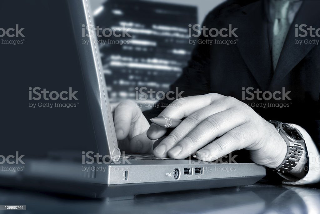 Close up of male hands holding a stylus at the keyboard royalty-free stock photo