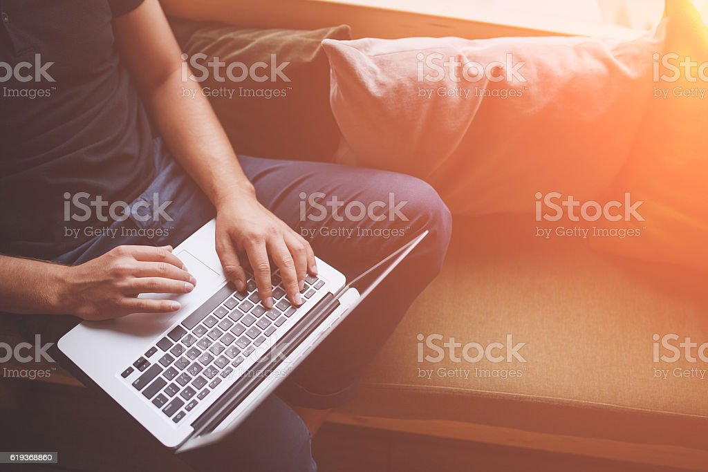 close up of male hands with laptop computer stock photo