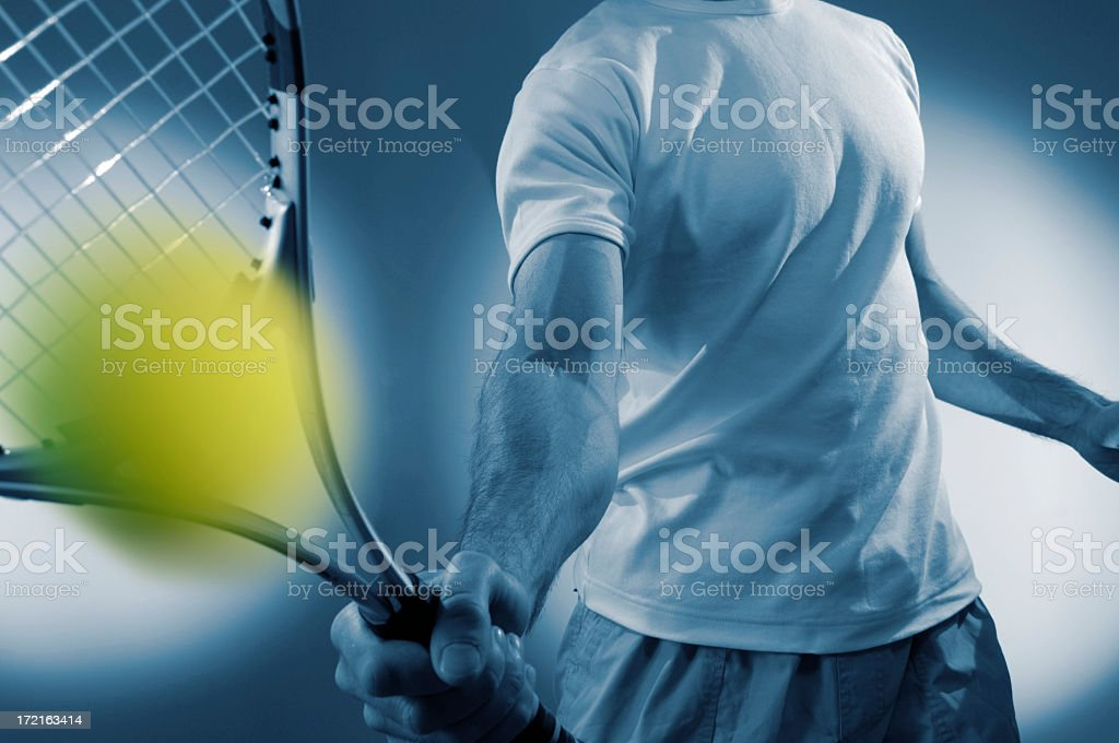 Close Up Of Male Tennis Player Hitting Ball stock photo