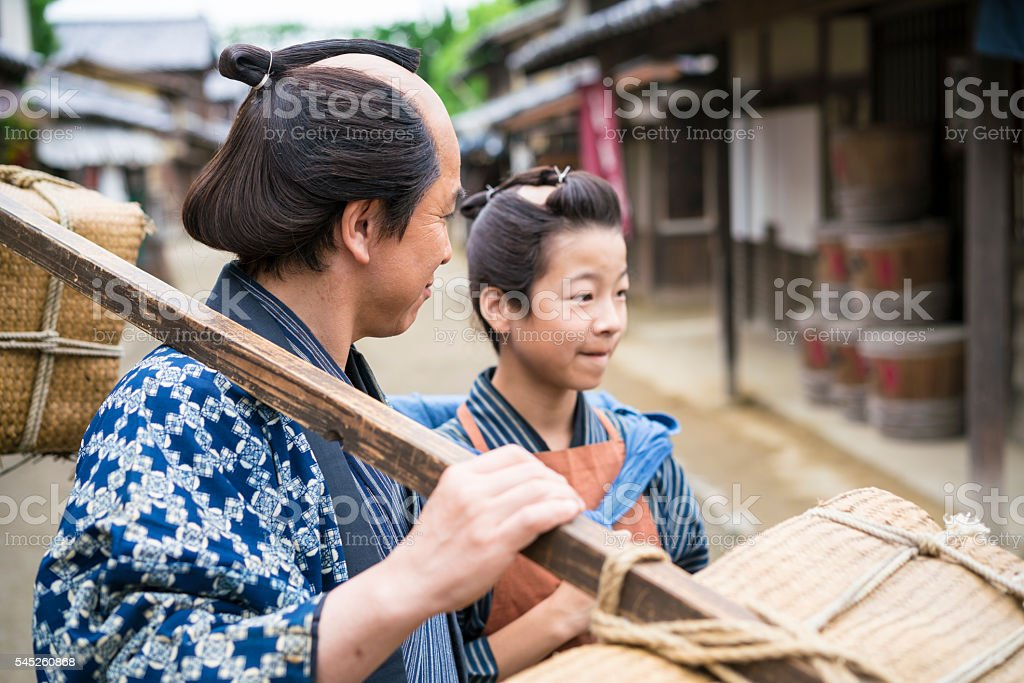 Close up of Man and boy while on street, Japan stock photo