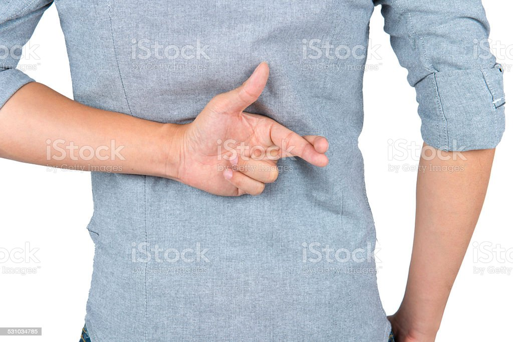 Close up of man back with fingers crossed behind. stock photo