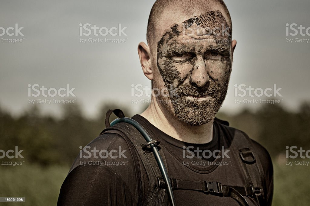 close up of man covered by mud stock photo