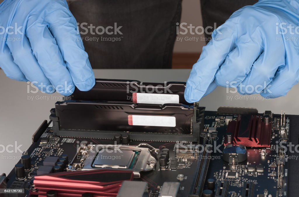 Close up of man hands  installing  memory module in slot stock photo