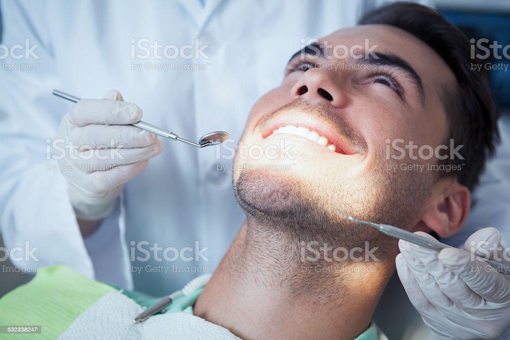 Close up of man having his teeth examined stock photo