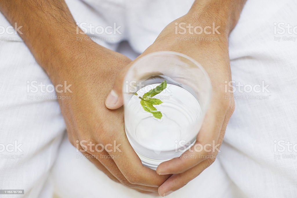 Close up of man holding glass of water royalty-free stock photo
