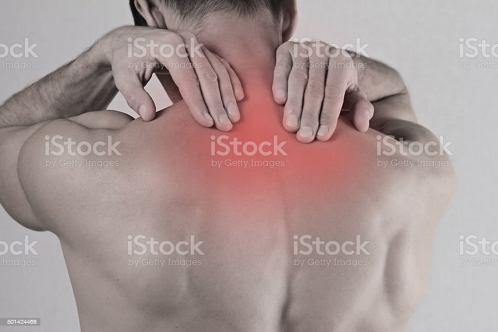 Close up of man rubbing painful back. Pain relief concept stock photo