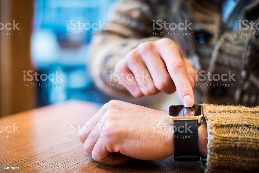 Close up of man using smartwatch stock photo