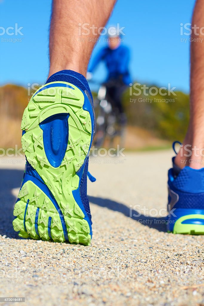 Close up of man walking in nature with biker royalty-free stock photo