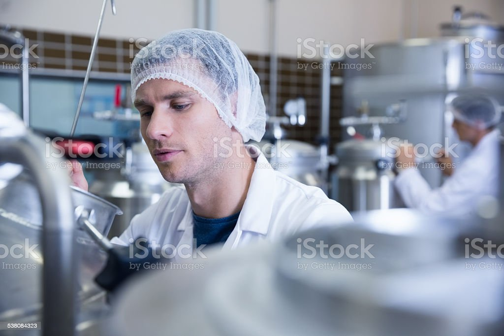 Close up of man wearing a hair net stock photo