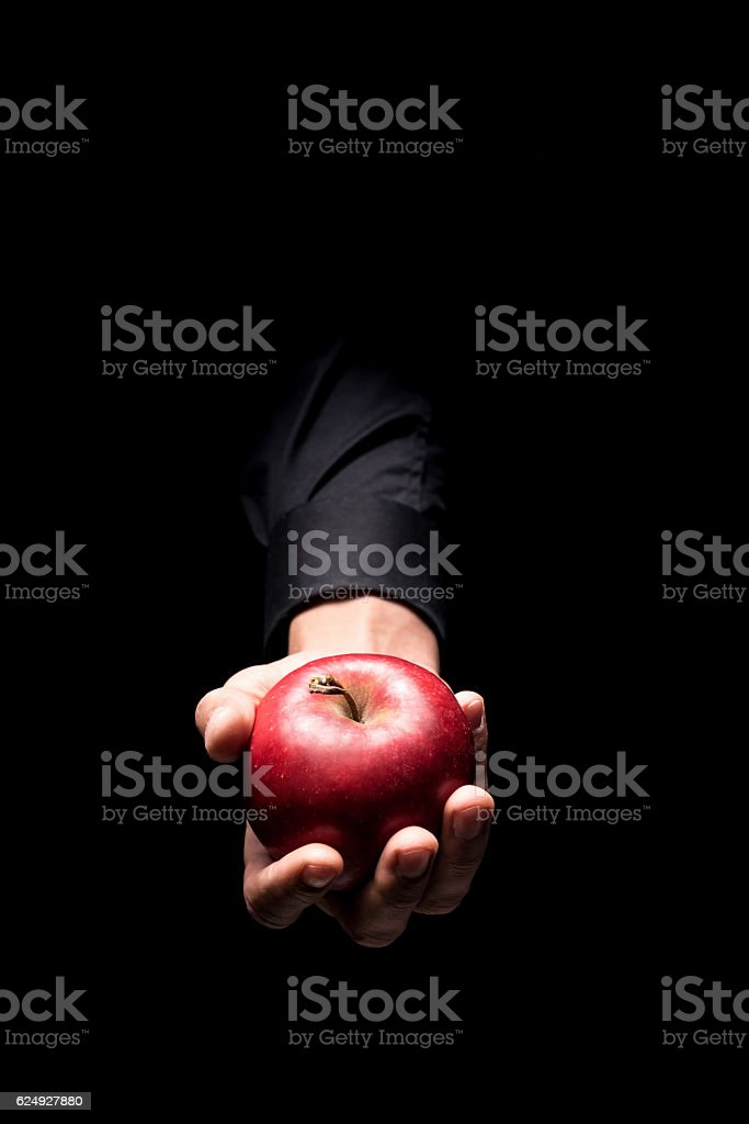 Close up of mans hand holding a red apple stock photo