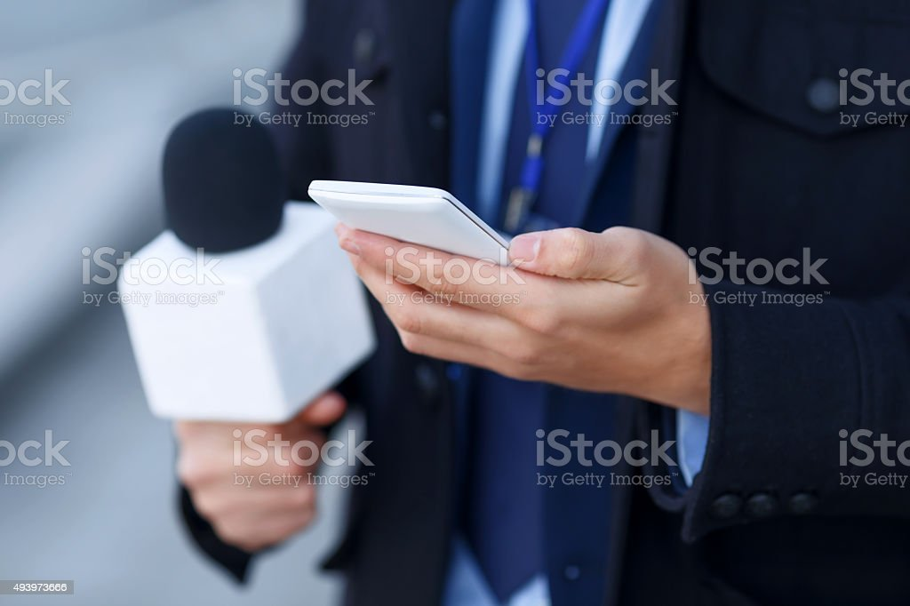 Close up of mans hand holding the smartphone stock photo