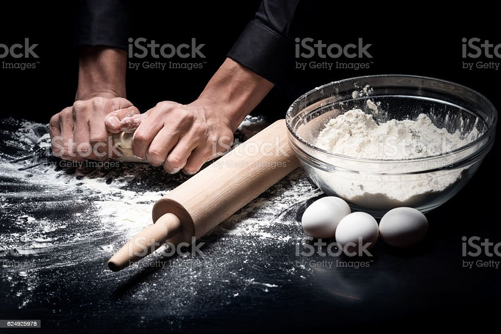 Close up of mans hands baking bread stock photo