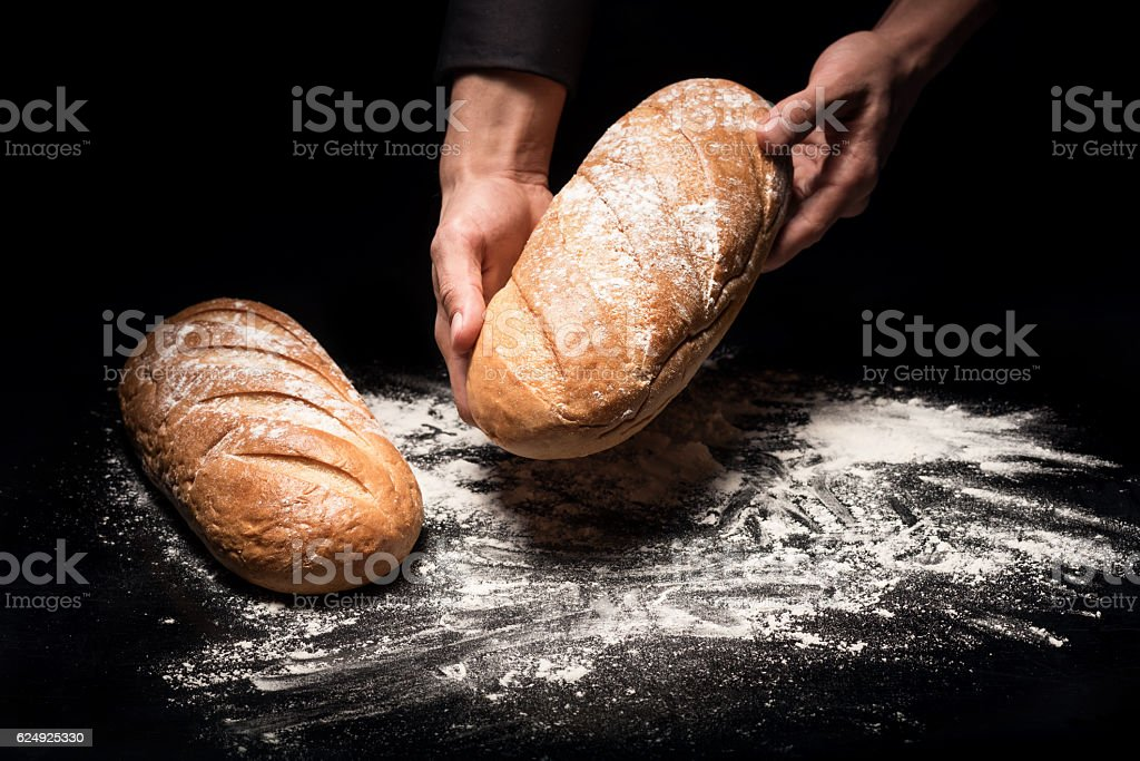 Close up of mans hands holding a bread stock photo
