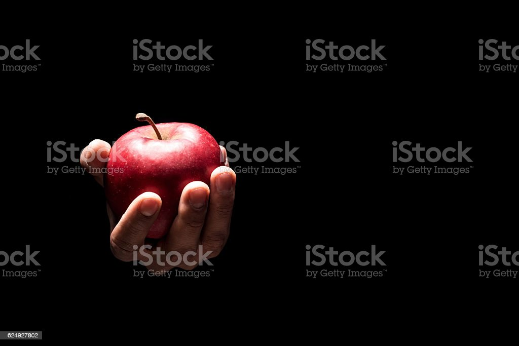 Close up of mans hands holding an apple stock photo