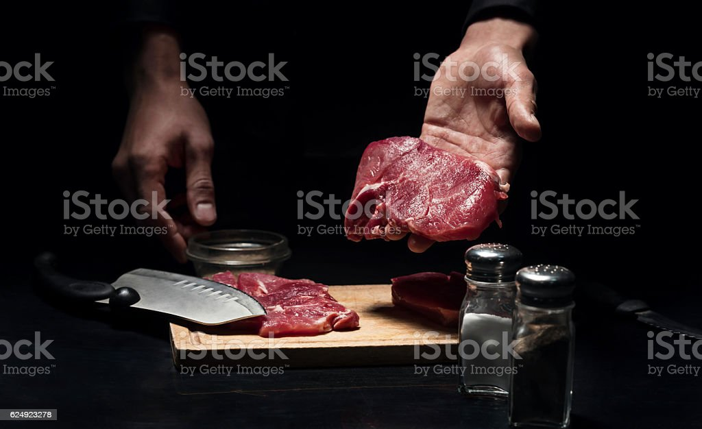 Close up of mans hands holding chopped meat stock photo