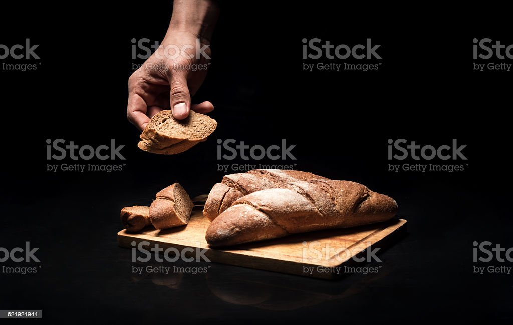 Close up of mans hands holding the baguette stock photo