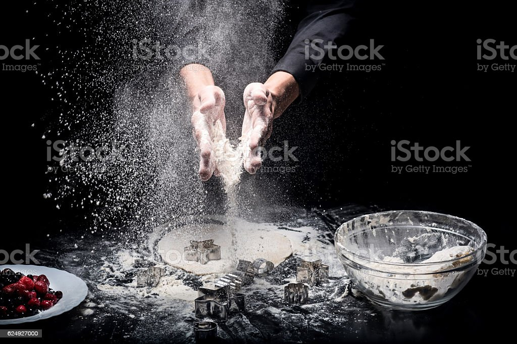 Close up of mans hands making cookies stock photo