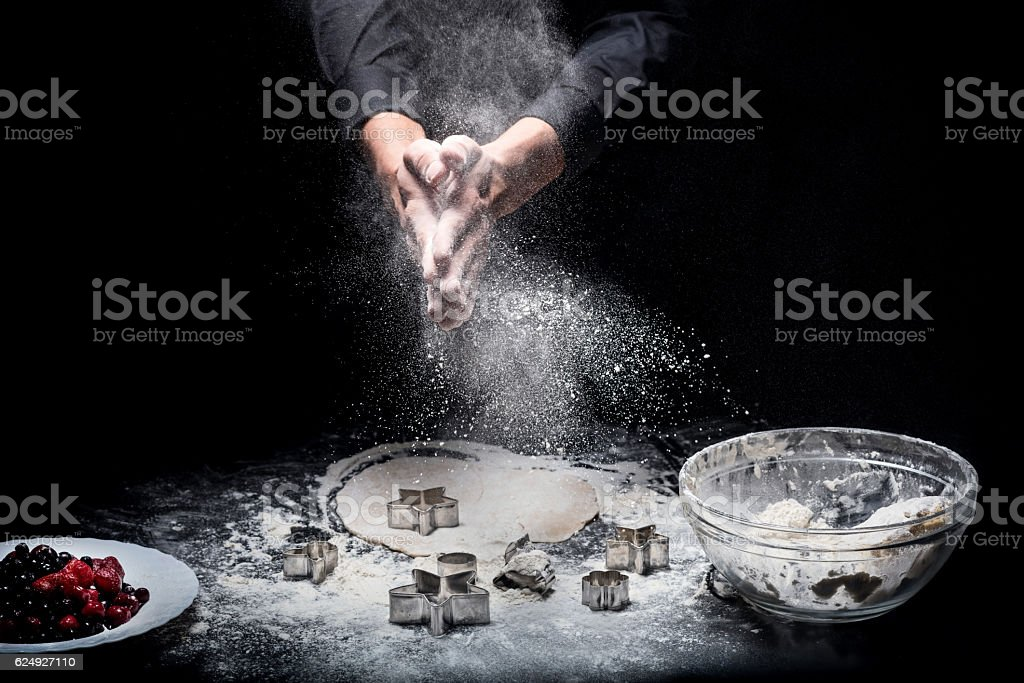Close up of mans hands preparing cookies stock photo