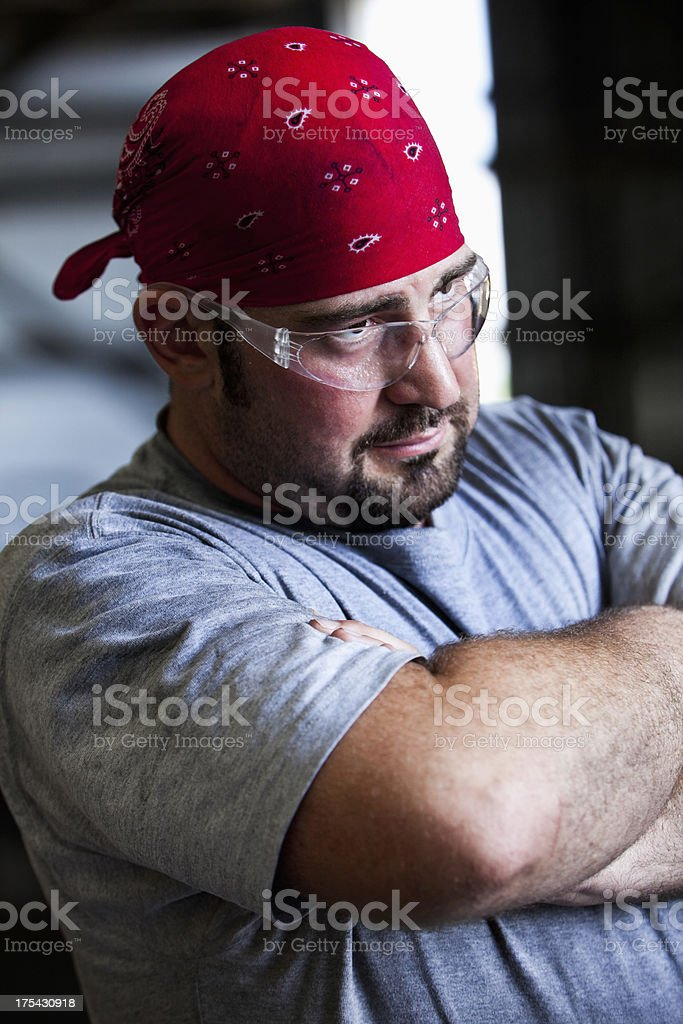 Close up of manual worker wearing safety glasses stock photo