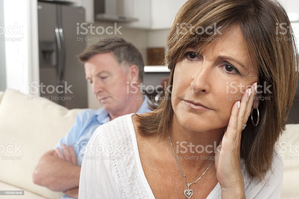 Close up of mature couple fighting stock photo