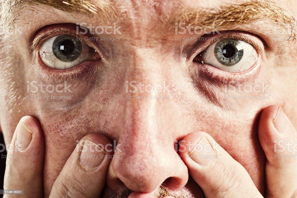 Close up of mature man feeling really terrible stock photo