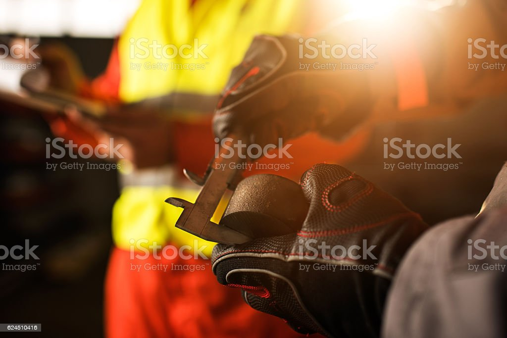 Close up of measuring steel with Vernier Caliper. stock photo