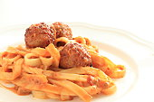 close up of meat ball and fettuccine