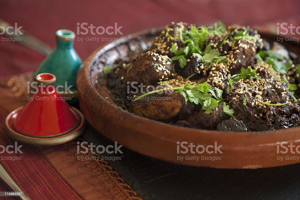 Close up of meat tagine with fresh coriander stock photo