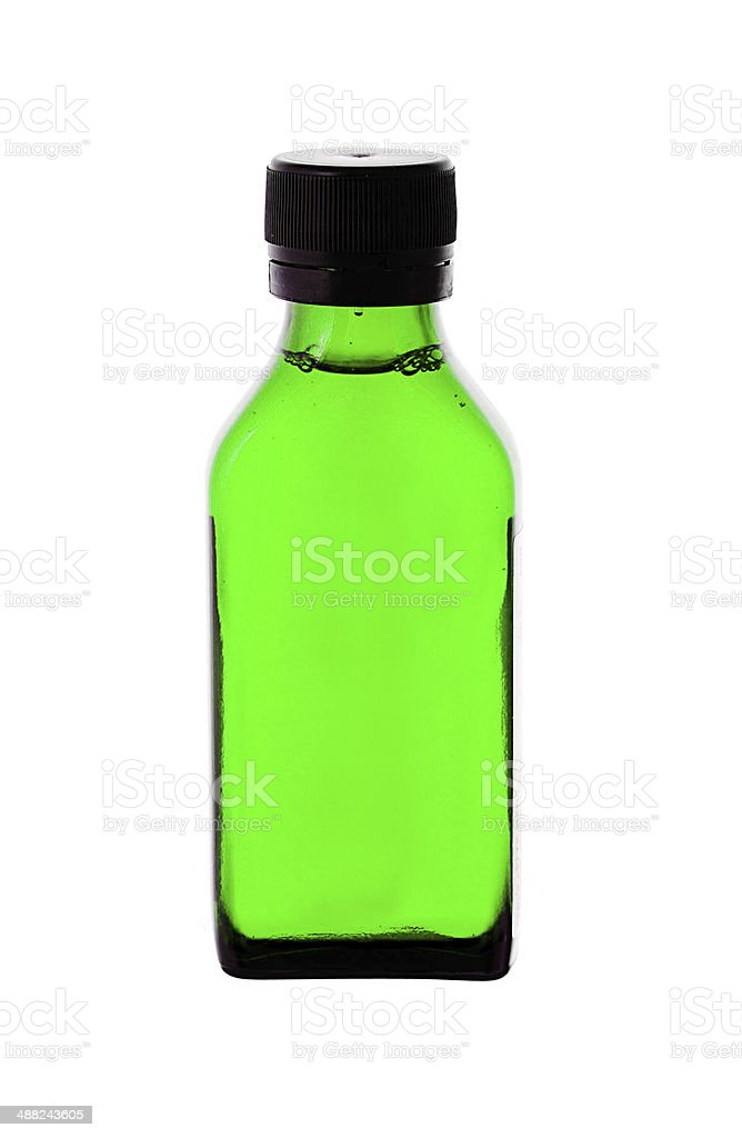 Close up of medicine bottle with green syrup isolated stock photo