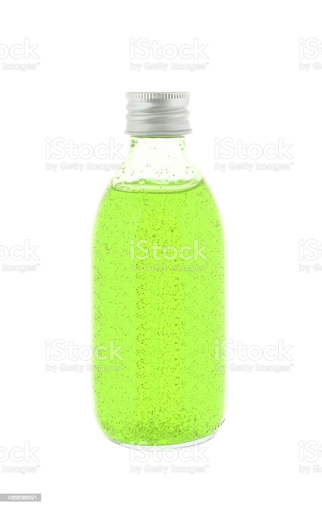 Close up of medicine bottle with green syrup stock photo
