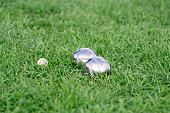 Close up of metal boule balls on the green lawn