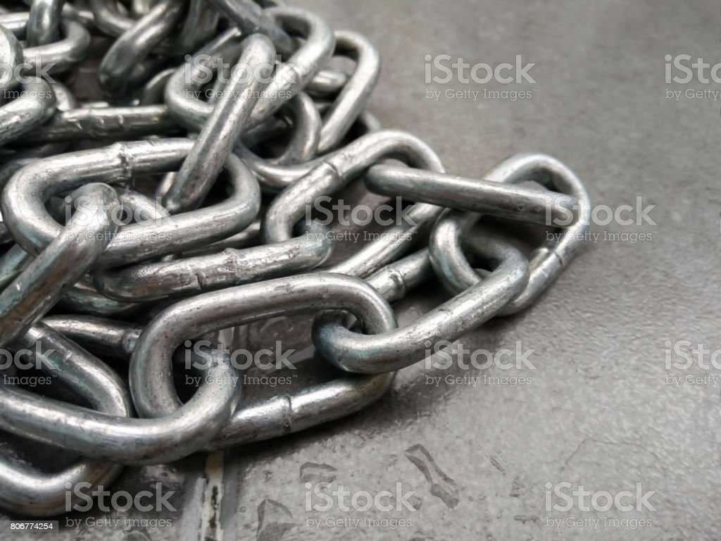 Close up of metal chain on the floor stock photo