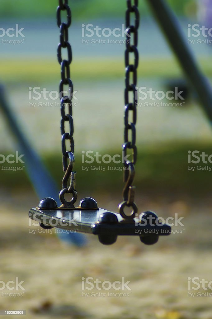 Close up of metal swing chair - Teeter board royalty-free stock photo