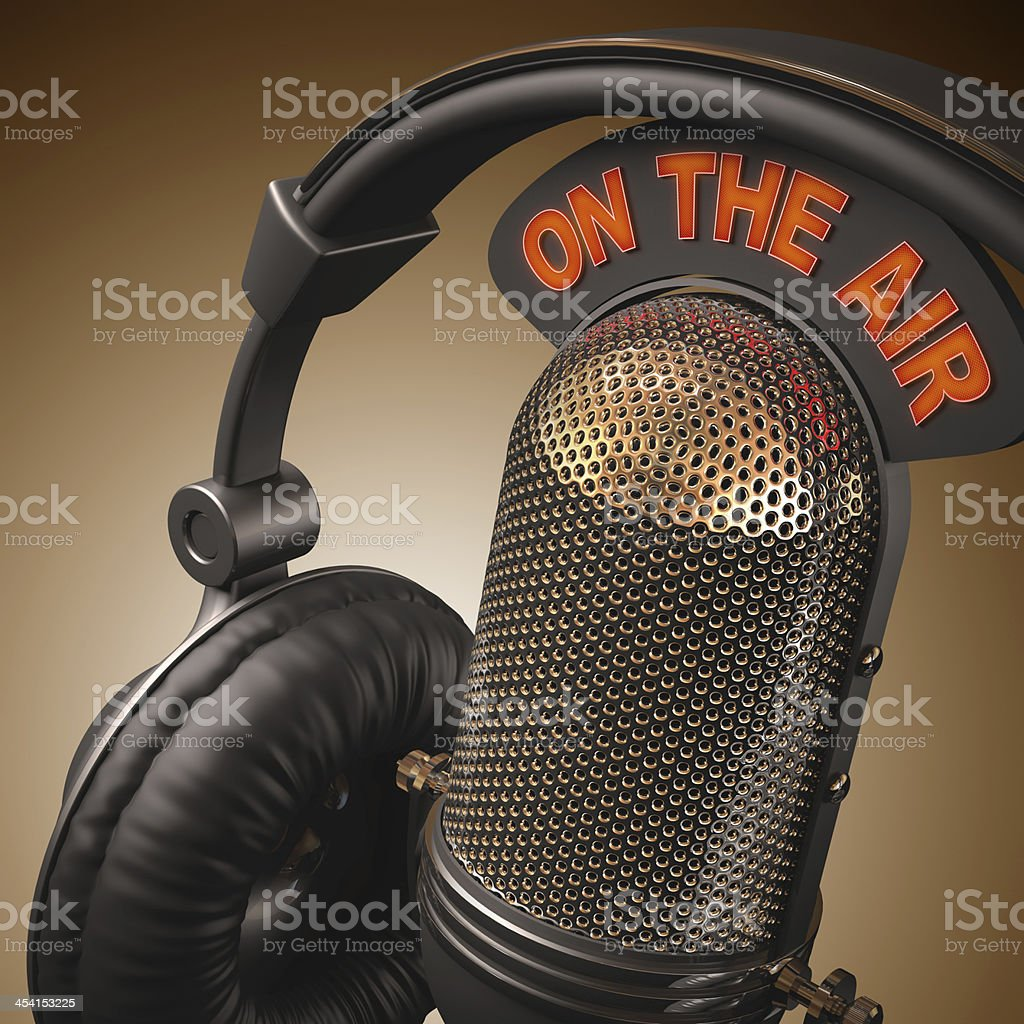 Close up of microphone and headphones with On The Air sign stock photo