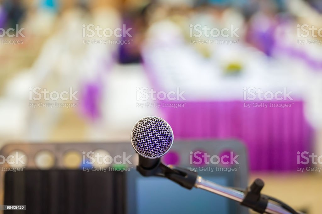 Close up of microphone in concert hall stock photo