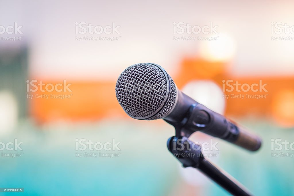 Close up of microphone in hall background. stock photo