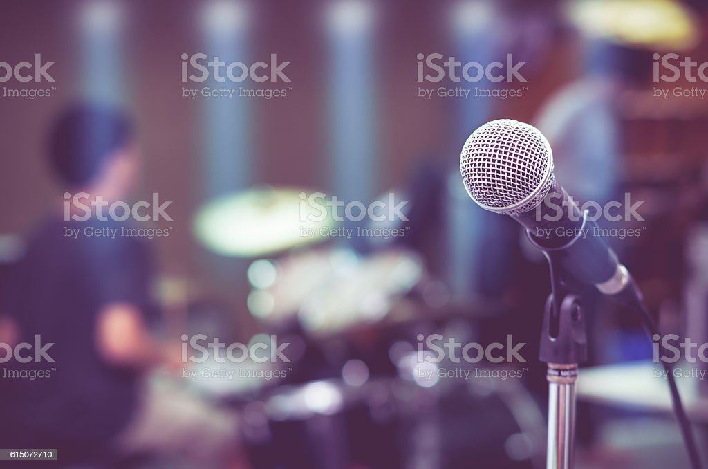 Close up of microphone on musician blurred background stock photo