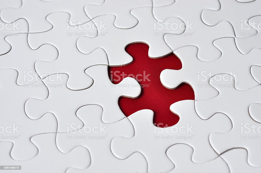 Close Up Of Missing Puzzle On Red Background, Selective Focus stock photo