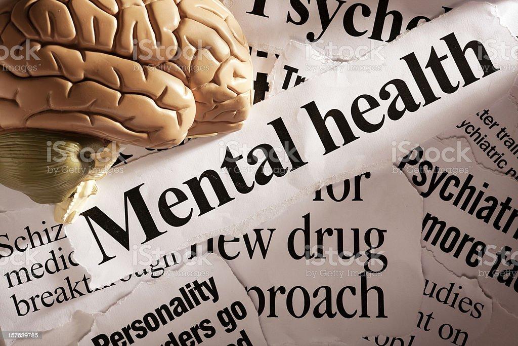 Close up of model brain on mental health headlines royalty-free stock photo