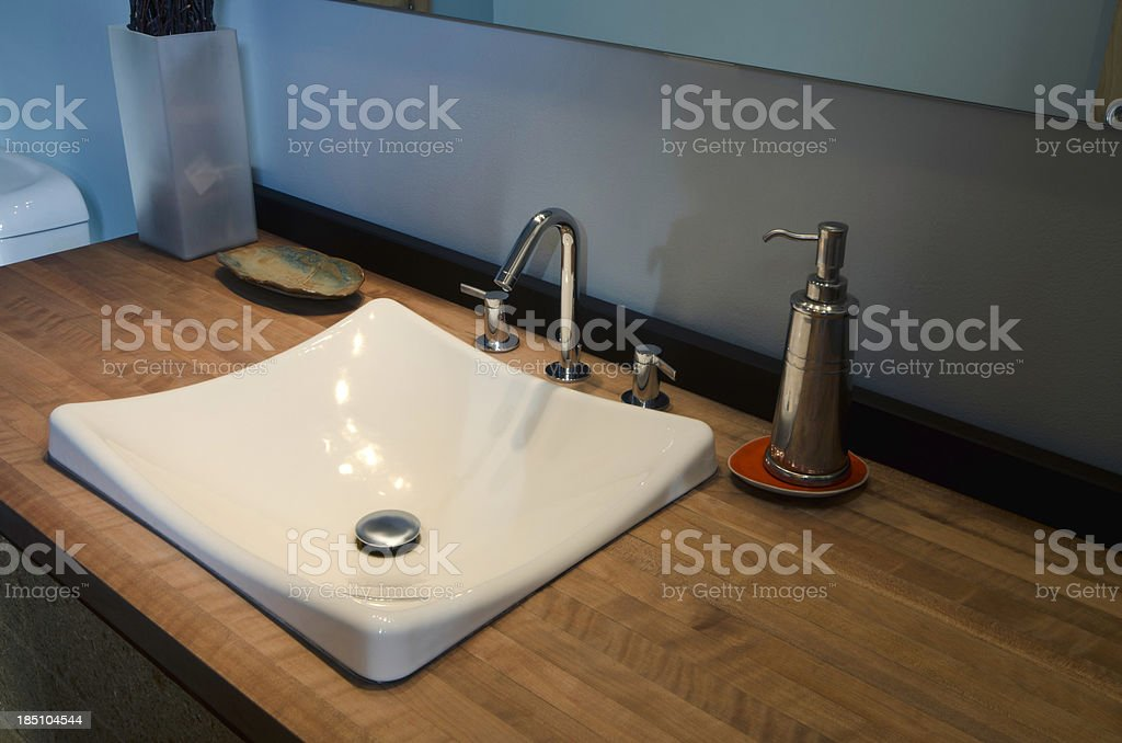 Close up of modern bathroom sink royalty-free stock photo