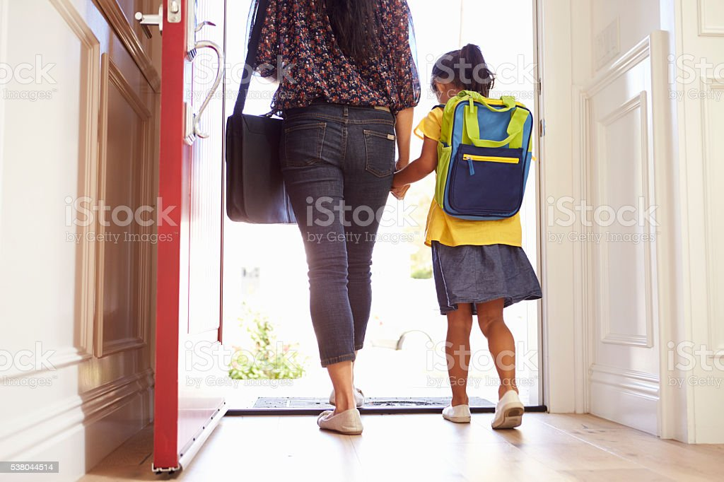Close Up Of Mother And Daughter Leaving For School stock photo