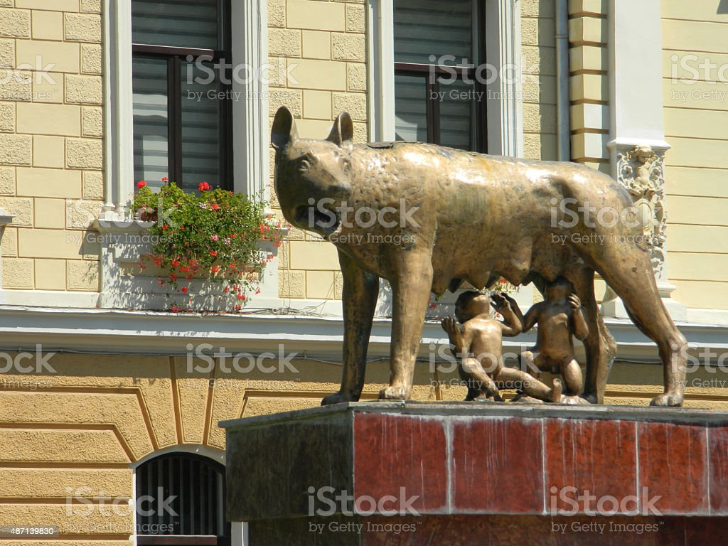 Close up of mother wolf with Remus and Romulus. stock photo