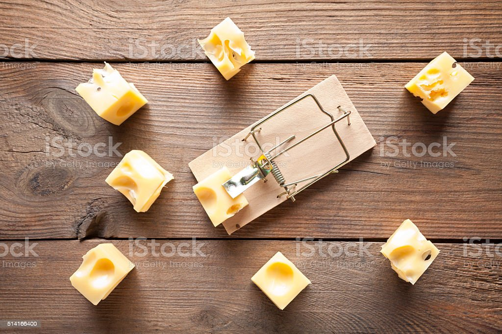 Close up of mouse trap on old wooden table stock photo