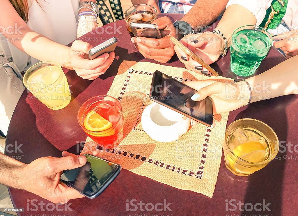 Close up of multiracial friend hands with mobile smart phones stock photo
