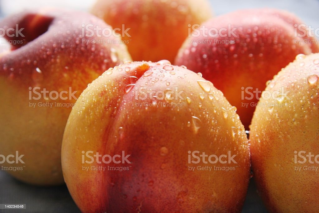 A close up of nectarines with water droplets on them stock photo