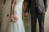 Close up of newlywed couple holding hands