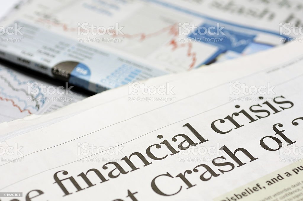 Close up of newspaper headline for financial crisis news stock photo