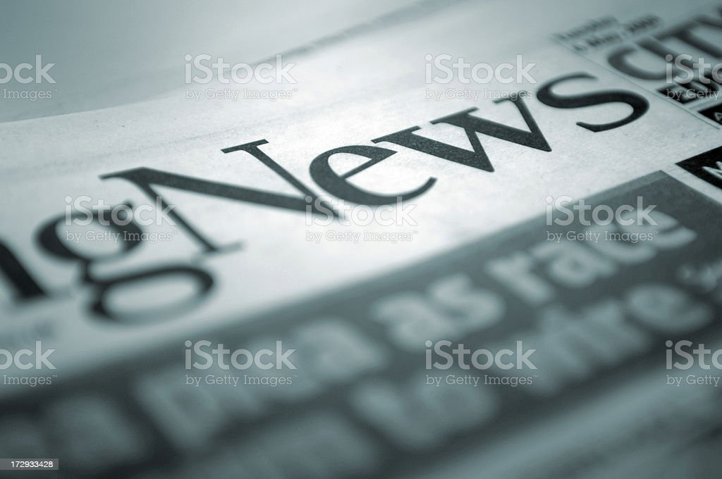 Close Up of Newspaper Title stock photo